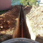 копаем траншею для канализации на основе септика из колец